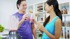 Young Ethnic Couple Enjoying Organic Fruit Drink Stock Footage