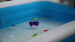 Wet fresh summer blue swimming pool 02 toys navigate Stock Footage