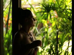 Woman drinking juice and looking on the garden Stock Footage