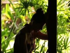 Sad woman leaning on door-frame Stock Footage