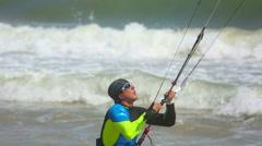 Man surfing on the waves with the kite. Mui Ne, Vietnam Stock Footage