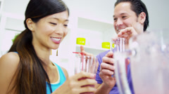 Young Ethnic Couple Drinking Blended Organic Fruit Drink Stock Footage