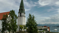 Europe Norway city of Molde 016 church tower, mountain landscape, cloudscape Stock Footage
