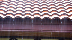 Rain runs off the roof. Video shift motion Stock Footage
