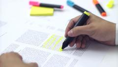 Student highlighting on a book Stock Footage