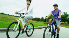 Young Heterosexual Ethnic Couple Cycling Fitness - stock footage
