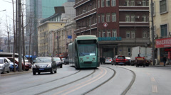 Tram going through downtown, Dalian Stock Footage