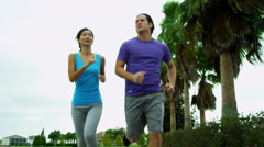 Athletic Asian Male Female Jogging Outdoors Stock Footage
