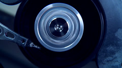Spinning hard-disc from inside with blue light Stock Footage