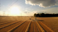 Stock Video Footage of Aerial of harvesting a grainfield wirth a combine harvester