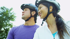Healthy Young Ethnic Couple Cycling Together Stock Footage