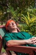 man has a rest in a deck-chair after an ayurveda-treatment - stock photo