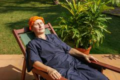 woman has a rest in a deck-chair after an ayurveda-treatment - stock photo