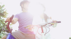 Asian Chinese Couple Exercise Outdoors Bicycles Stock Footage