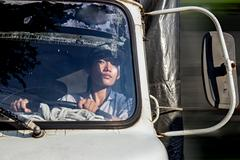 Woman truck driver in the car Kuvituskuvat