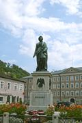 statue of mozart in salzburg - stock photo