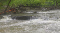 Stormy mountain river running over rocks Stock Footage