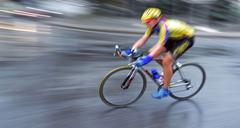 Stock Photo of speedy bicyclist in motion background blur