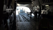 Stock Video Footage of C-17 Globemaster Aircraft and cargo deploy to Nellis Air Force Base