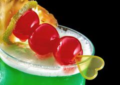Green cocktail with yellow heart, valentine's day, cherry, iso Stock Photos