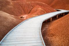 Raised walkway through the red hills of the painted hills Stock Photos