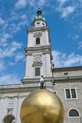 man on golden sphere in salzburg - stock photo