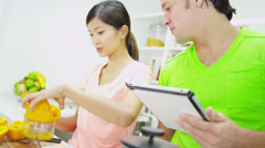 Young Asian Chinese Couple Wireless Tablet Kitchen Breakfast - stock footage