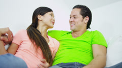Relaxed Multi Ethnic Couple Talking Home Sofa Stock Footage