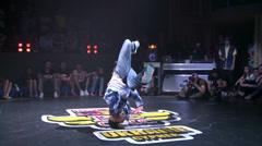 Bboys battle on the dance floor in a nightclub, hip-hop, break dance. - stock footage