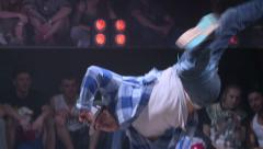 B-Boy Break Dancing on the dance floor in a nightclub Stock Footage