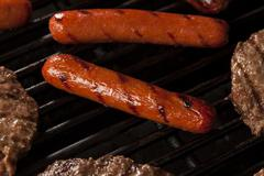 hamburgers and hot dogs on the grill - stock photo