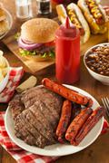 grilled hamburgers and hot dogs - stock photo