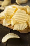 unhealthy crinkle cut potato chips - stock photo