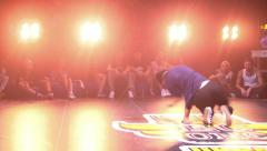 Stock Video Footage of BBoy on the dance floor in a nightclub. Hip-hop, break dance.