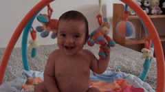Happy baby and toys around Stock Footage