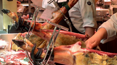 Slicing of jamon at the La Boqueria food market. Barcelona, Spain. - stock footage