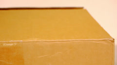 Hand open cardboard box. Video shift motion Stock Footage