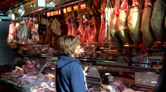 Buyer in the butcher shop. La Boqueria food market, Barcelona, Spain. Stock Footage