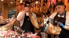 Slicing of jamon at the La Boqueria food market. Barcelona, Spain. Stock Footage