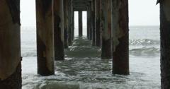 1814 Ocean Waves Crashing Under Pier, 4K Stock Footage