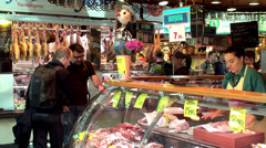 La Boqueria food market at Barcelona. Meat ranks. Stock Footage