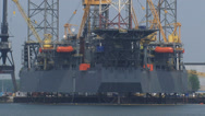 Stock Video Footage of jackup rig Rowan Gorilla VI moored at shipyard Keppel Verolme + zoom out