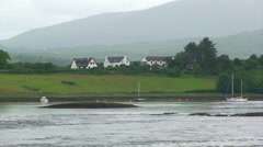 Falling tide on fjord with white houses Stock Footage