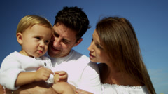 Devoted Young Parents Baby Boy Outdoors Stock Footage