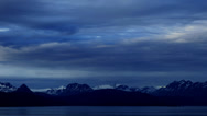 Stock Video Footage of Time lapse: Clouds over Alaskan mountains and glacier