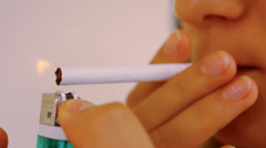 Close up of real young woman smokes, selective focus. Video macro time lapse - stock footage