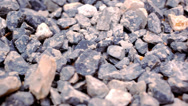 Stock Video Footage of Close-up of crushed gravel. Macro video shift motion