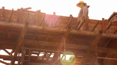 KOH SAMUI, THAILAND - JUNE 21: builder worker at roofing construction works. Stock Footage