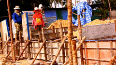 KOH SAMUI, THAILAND - JUNE 21: heaps of clay foundation and builders in the Stock Footage
