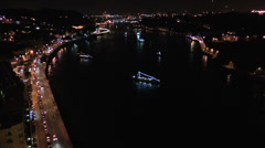 City at night, panoramic scene of downtown reflected in water Stock Footage